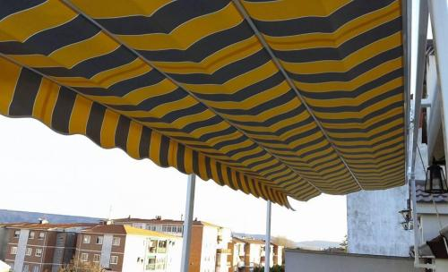 Toldos en guadalajara for Piscina cubierta marchamalo